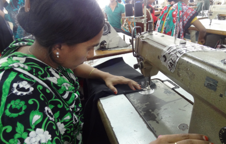 A woman sewing on a machine