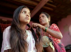A girl in India getting her hair done