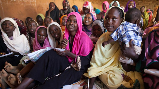 A group of women are gathered to take English classes in the Abu Shouk camp for internally displaced people in North Darfur, Sudan.