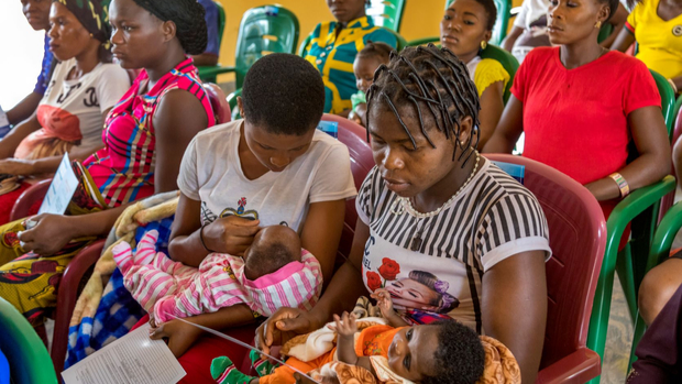 Women and children in the waiting room of a health clinic in Nigeria.