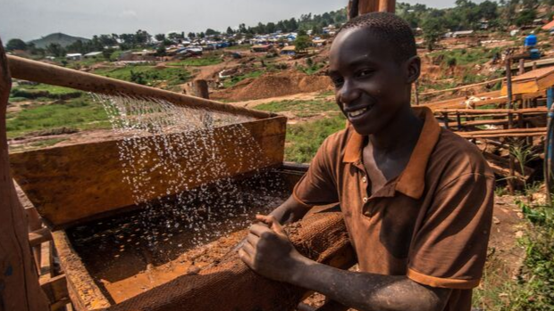 At a mining site in central Uganda,Kasadha Denis operates a Z machine,which seperates gold particles from sand.