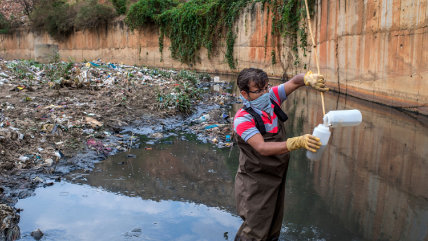 Praveen,Lab analysist collect the polluted water sample from the stream flowing from Summanahalli in the Banglore city.