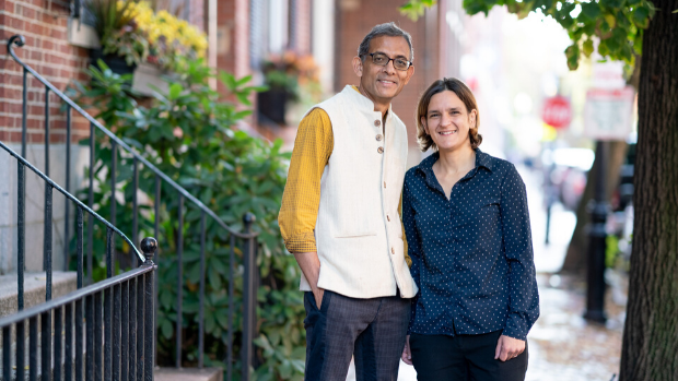 MIT economists Abhijit Banerjee and Esther Duflo stand outside their home.