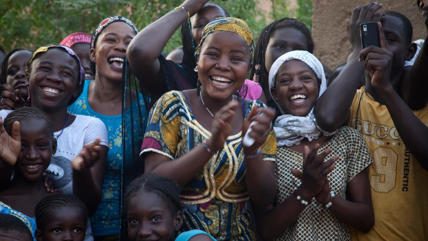 Youth in Mali attend a theatre performance that promotes peace and reconciliation.