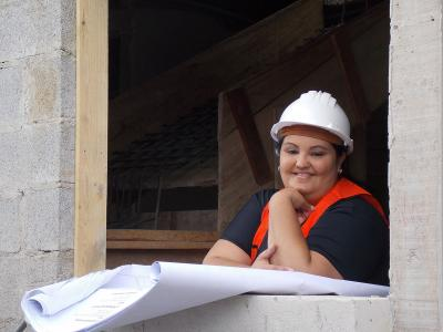 A woman at a construction site.