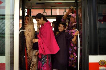 Women and children riding the Lahore Bus Rapid Transit (Lahore Metro Bus) service