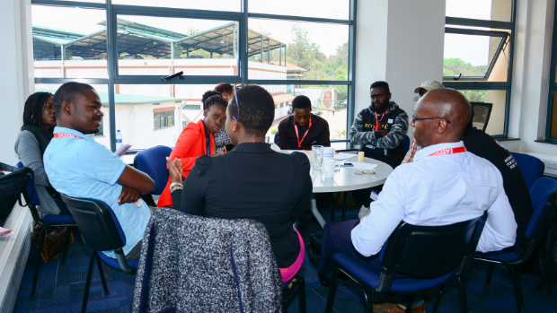 Picture shows a group of researchers meeting for a Focus Group Discussion in Nairobi Kenya, in 2017.