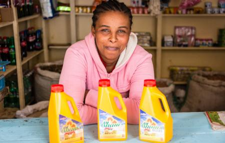A local shopkeeper selling vitamin A-fortified sunflower oil in Tanzania