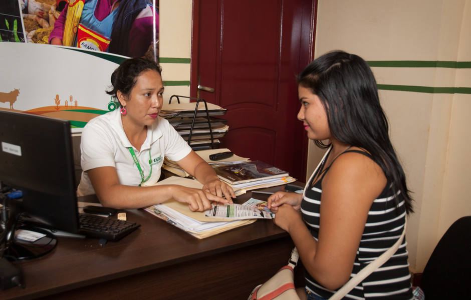 Lilian Suarez Fernandez learns about credit options for her fisheries.
