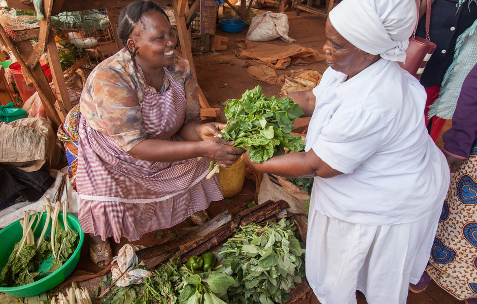 Smallholder farmer Elizabeth Waithira sells her produce at the Kandara Market.