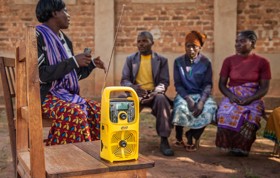 A listening club in the village of Liulahumba tunes in to radio programs that feature interviews with other farmers and facts about soybeans.