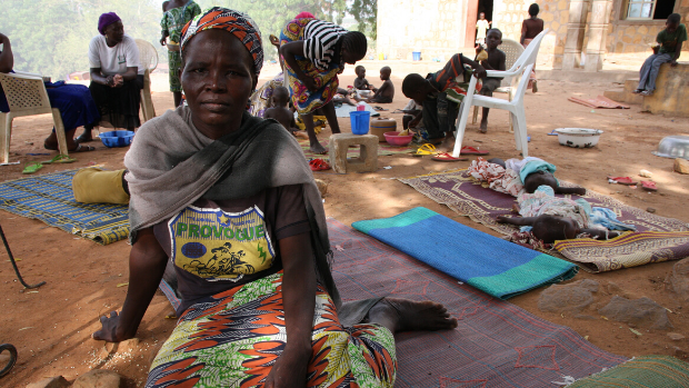A woman sits on the floor in an informal settlement for displaced persons in Yola, Nigeria.