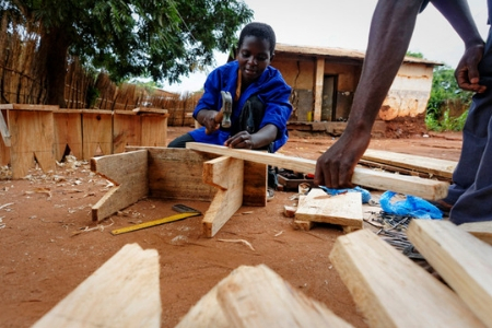 Young woman named Pamela training in carpentry.