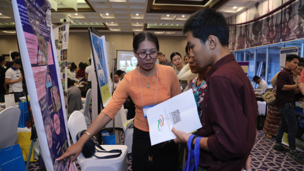 An information booth at a 2019 knowledge marketplace in Myanmar.