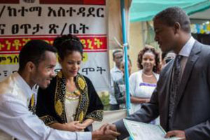An Ethiopian couple receives an official marriage certificate.