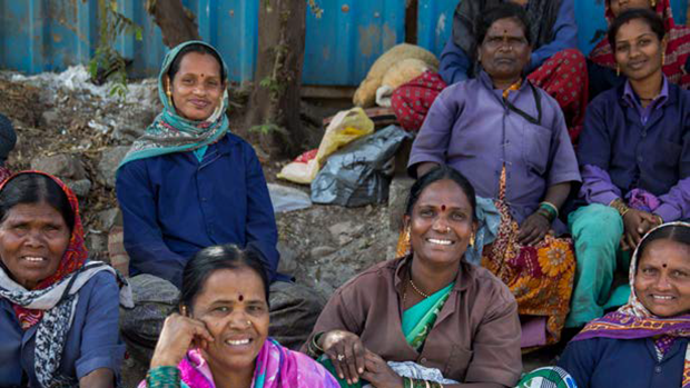 a group of women and men in India