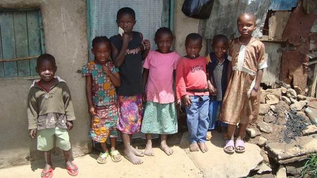 Children pose in front of a house in the informal settlement of Mathare, in Nairobi, Kenya.