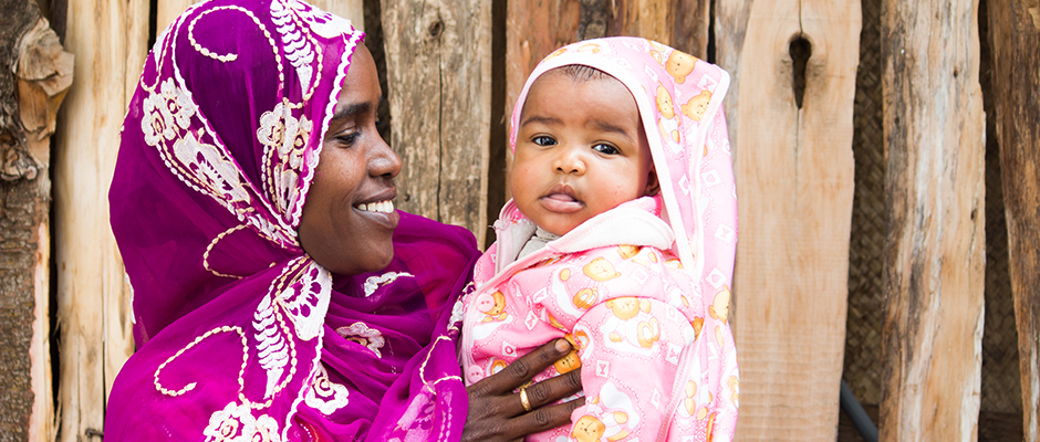 An Ethiopian woman holding her baby