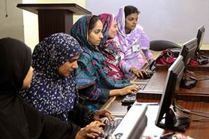 Young women learn computer skills, Hyderabad, Pakistan