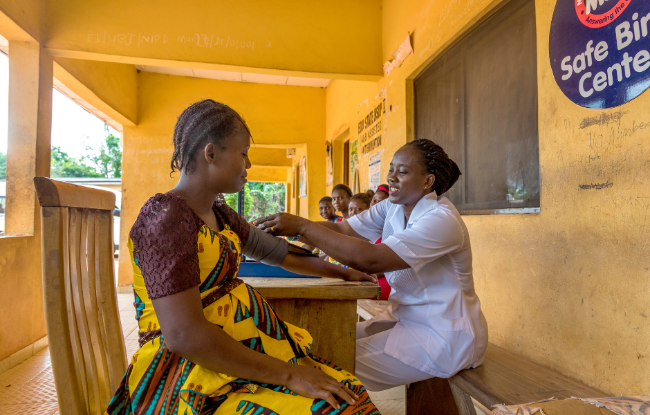 Nurse Mary Ogun takes vital signs of pregnant clients at the Ewatto community Primary Health Center  in Edo state, Nigeria.