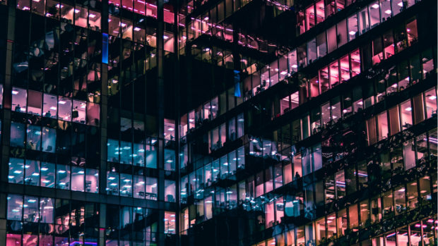 Multi-coloured lights illuminate office towers.