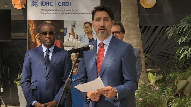 Canadian Prime Minister Justin Trudeau delivers a speech in front of IDRC's Central and West Africa office. Amadou Hott, Senegal's Minister of the Economy, Planning and International Cooperation, stands in the background.