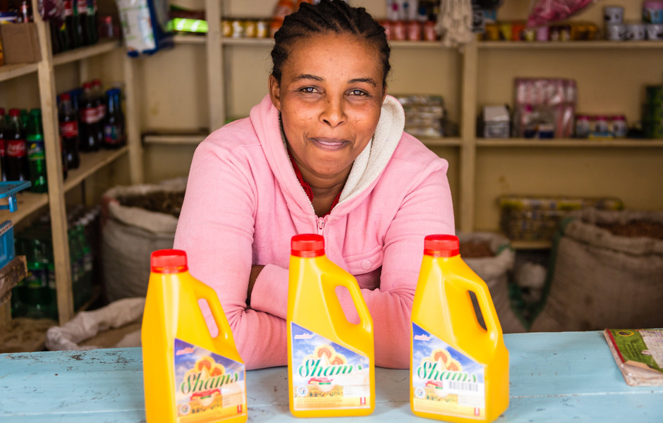 A local shopkeeper selling vitamin A-fortified sunflower oil.