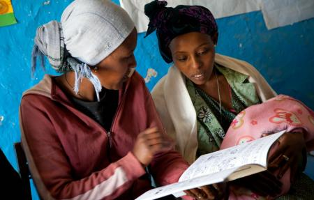Health Extension worker discusses Health and Nutrition with a mother