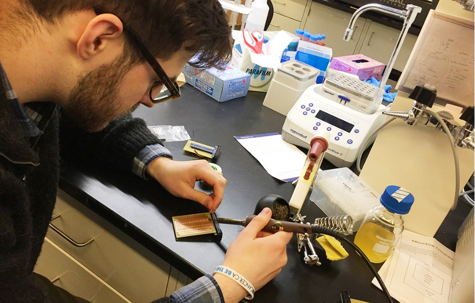 Darius Rackus, a member of Keith Pardee's lab at the University of Toronto, assembles portable diagnostic equipment that will be used to test for Zika and other diseases in South America.