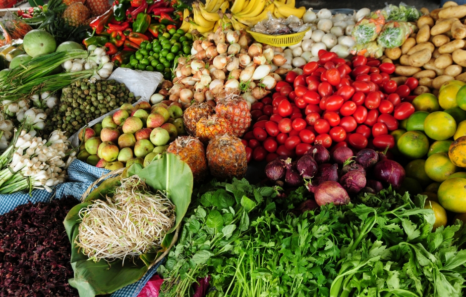 Fruits, vegetables and greens, for sale in a market in Guatemala City, Guatemala.
