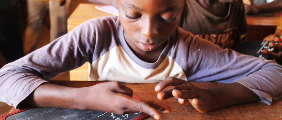 A primary school student sitting at his desk in the Central African Republic.