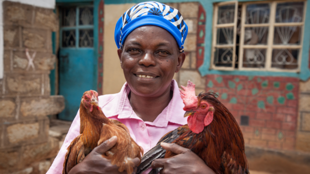 Woman holding two chickens