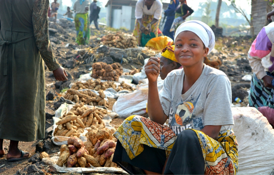 A woman sells tubers at a camp for internally displaced persons in the Democratic Republic of the Congo.