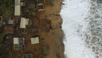 Waves wash ashore at Fuvemeh, a town in Ghana's Volta River delta that's threatened by coastal erosion and flooding.