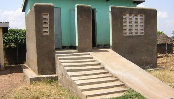 Raised latrine with accessible ramp