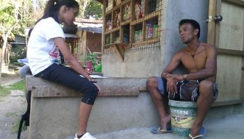A man and a girl talking