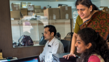 Two women looking at a computer in India