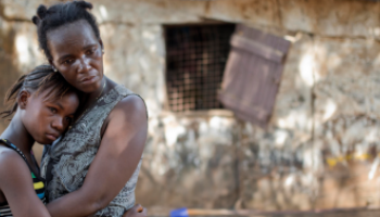 A mother holding her daughter Freetown, Sierra Leone