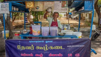 Street vendor M. Desinguraja's food stand is in a high traffic area and sees plenty of business.