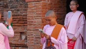 Buddhist nuns taking photos of each other in Myanmar