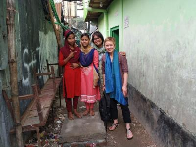 Ayesha Khatun and Moon Begum, residents of the Korail slum in Dhaka, pose with icddr,b researchers Sohana Shafique and Alayne Adams.