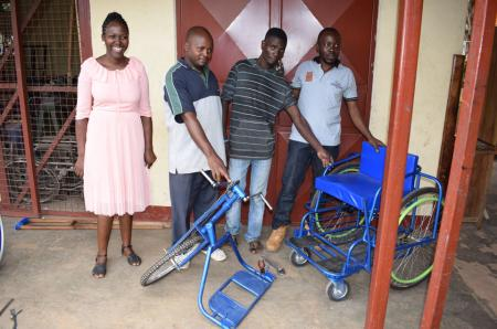 Locals from Uganda's Kasese District show off a new hand-pedalled tricycle that converts into a wheelchair
